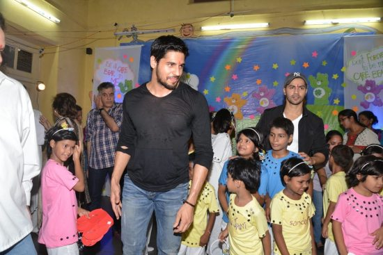 Varun-Dhawan-And-Siddharth-Malhotra-meet-at-an-ngo41