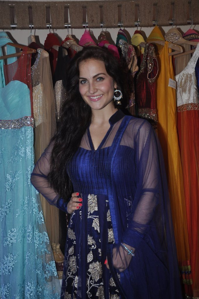 Stunning in blue! Swedish beauty Elli Avram attends Nazakat store launch.