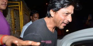 Shahrukh Khan and Karim Morani discuss at Mumbai restaurant