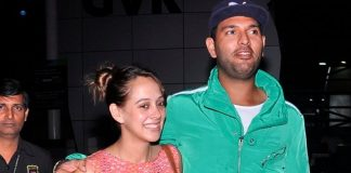 Yuvraj Singh and Hazel Keech happily pose for shutterbugs at airport