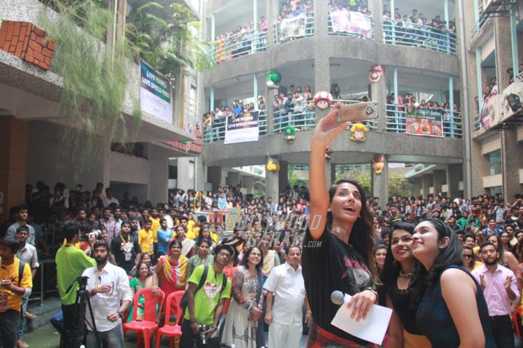 Monica Dogra takes a selfie with the crowd at College Fest
