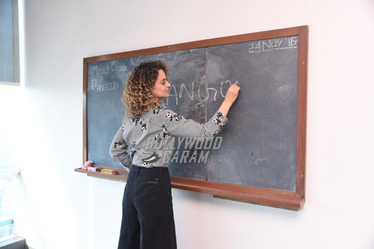 Kangana Ranaut scribbling on the blackboard at Rangoon promtions
