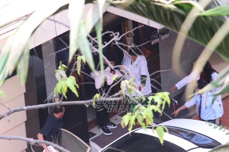 Karan Johar brings twins Yash and Roohi home
