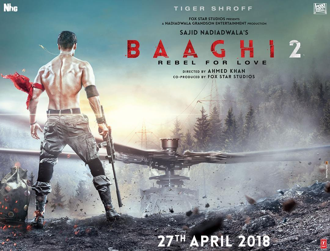 Baaghi 2 Poster - Tiger Shroff makes heads turn with his chiseled body!