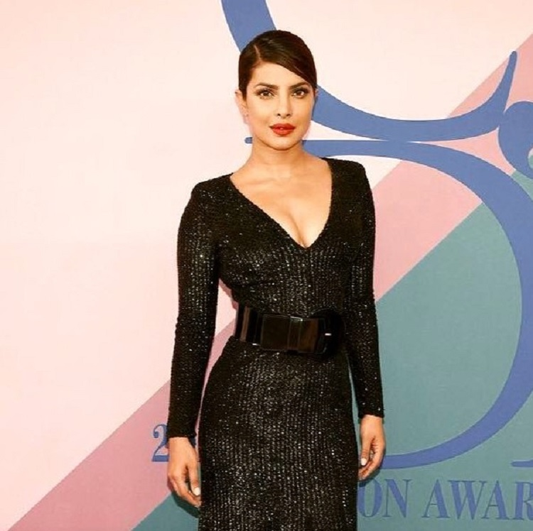 Priyanka Chopra looks sultry in this black gown with plunging neckline