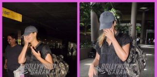 Nargis Fakhri hides her face as she gets papped at airport