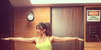 Soha Ali Khan strikes a yoga pose with her growing baby bump