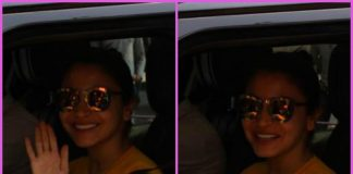 Anushka Sharma smiles and waves for cameras at a studio